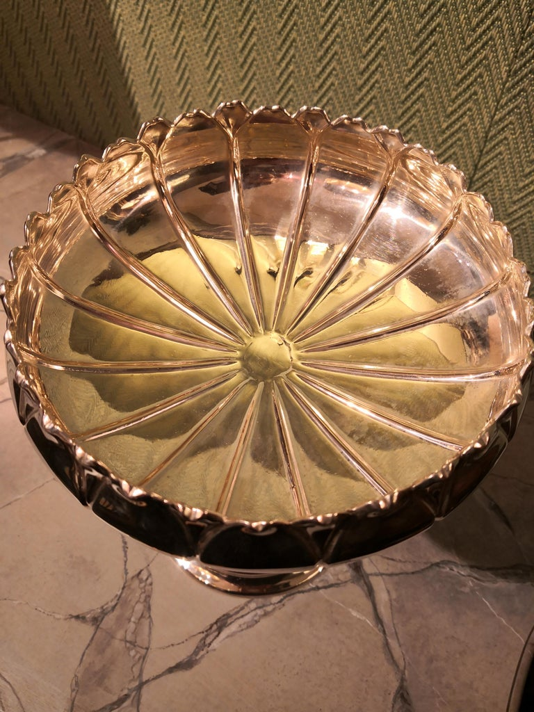 Hugh German Art Nouveau centerpiece bowl in 800 silver. The bowl is shaped as a water lily blossom with the characteristic leaves left and right hand underneath the blossom. Round stand with a naturalistic water lily bud . Stamped 800 and German
