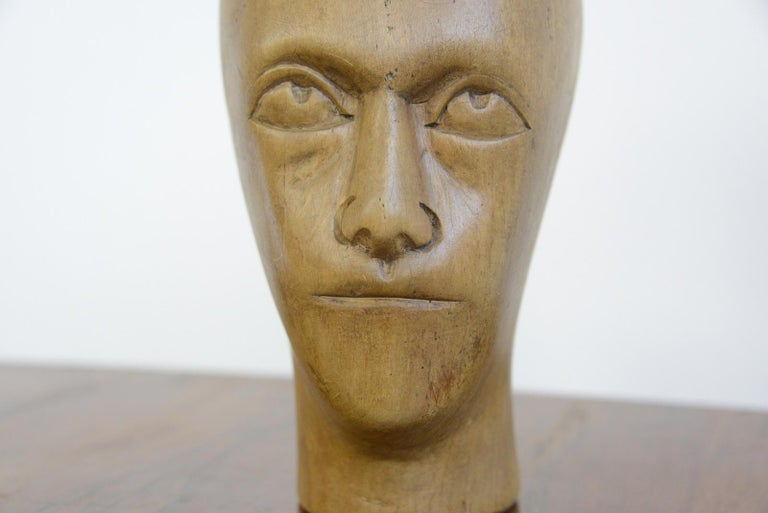 German carved wooden milliners head, circa 1910  - Hand carved from sycamore - Used in the displaying and making of hats - German, 1910 - Measures: 25 cm tall x 15 cm wide x 18 cm deep  Condition report  Signs of its previous in the form of