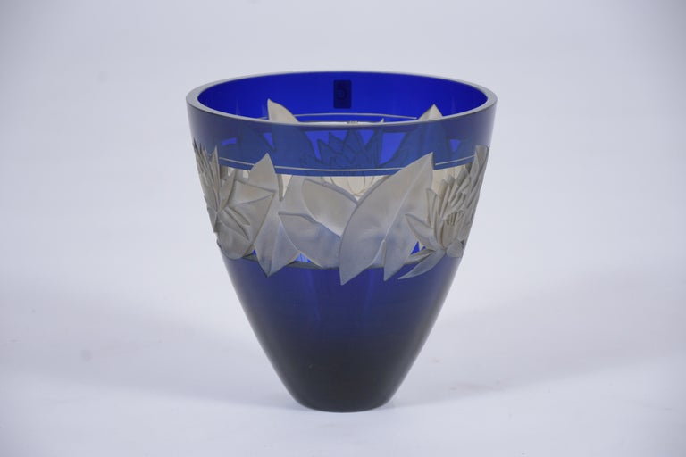 An extraordinary vintage vase beautiful crafted out crystal in great condition. This fabulous glass centerpiece by Christinenhutte from Germany features an elegant cobalt blue color a remarkable etched floral details. This cobalt blue crystal vase