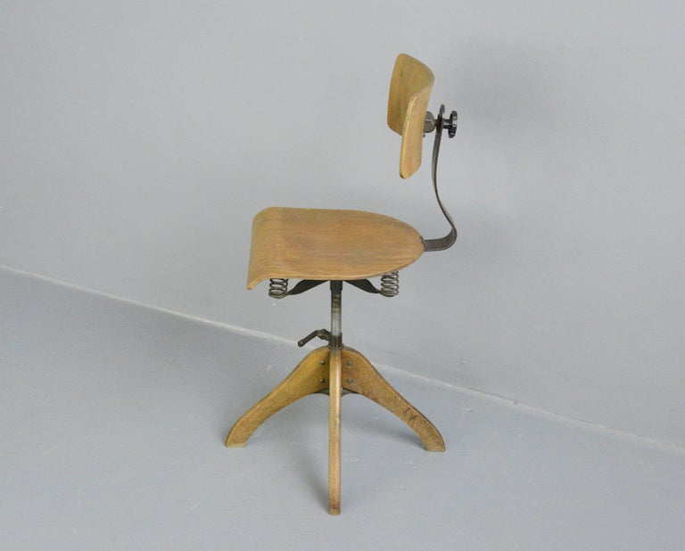 German draftsman's chair by Polstergleich, circa 1930s  - Height adjustable - Sprung seat and backrest - Beech legs, seat and backrest - Bakelite backrest knob with makers mark - German, 1930s - Measures: 40cm wide x 48cm deep - Seat height