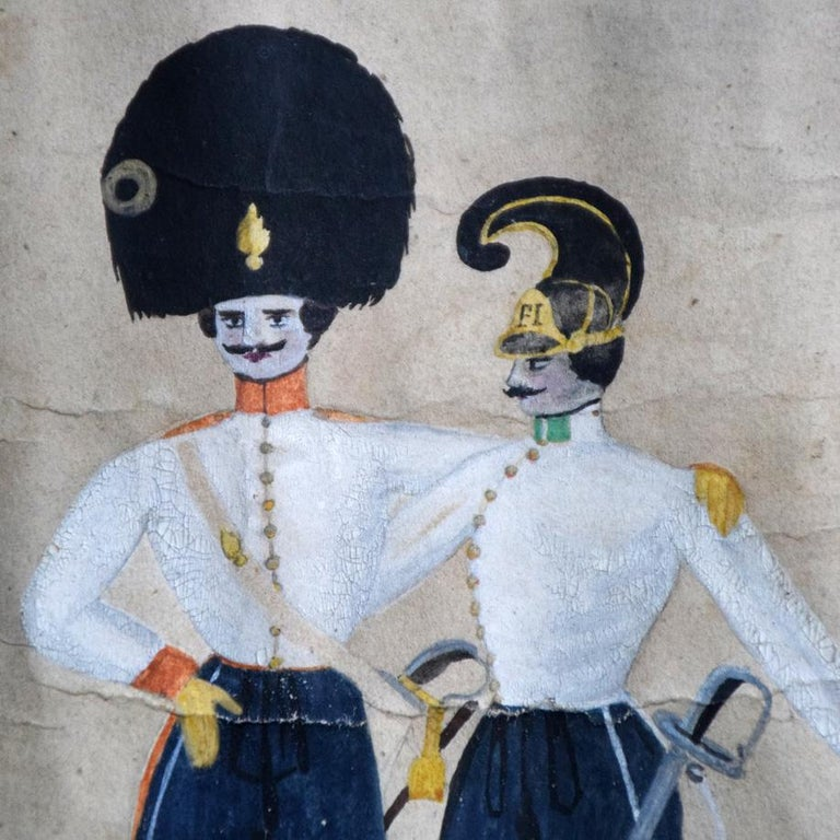 A wonderful example of a circa 1870 German Folk Art naïve military scene in townscape annotated to celebrate a soldier. In ceremonial regalia in watercolour & gouache framed in its period maple frame. The detail across this painting is quite