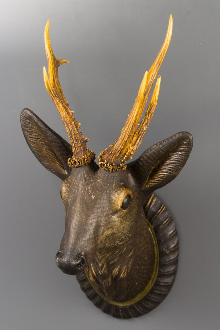 Early 20th Century German Hand Carved Wooden Deer Head with Antlers on Carved Wall Plaque For Sale