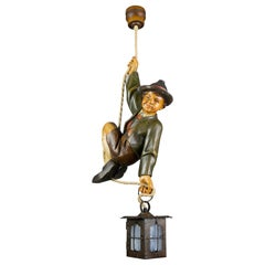 German Hanging Lamp with Hand Carved Sculpture of Mountain Climber and a Lantern