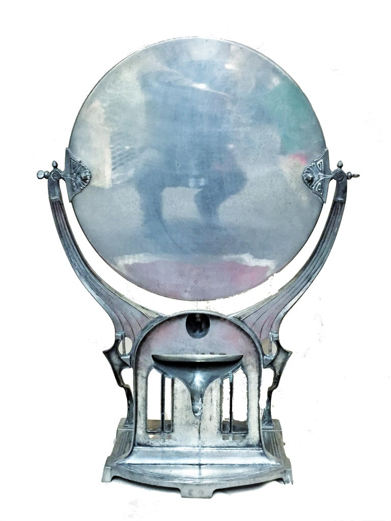 Dimensions: Height 18-3/4 inches  Width 28-1/2 inches  Depth 4-15/16 inches  This grand vanity mirror in the secessionist taste features three laconically designed but highly functional sections. The upper section is a large round swiveling