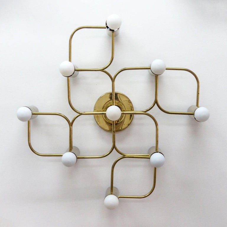Stunning nine-light flush mount light fixture in brass with beautiful patina by Leola Germany, can be used as wall or ceiling light, wired for US standards, nine E12 sockets, max. wattage 40w per socket, bulbs are provided as a one time courtesy.