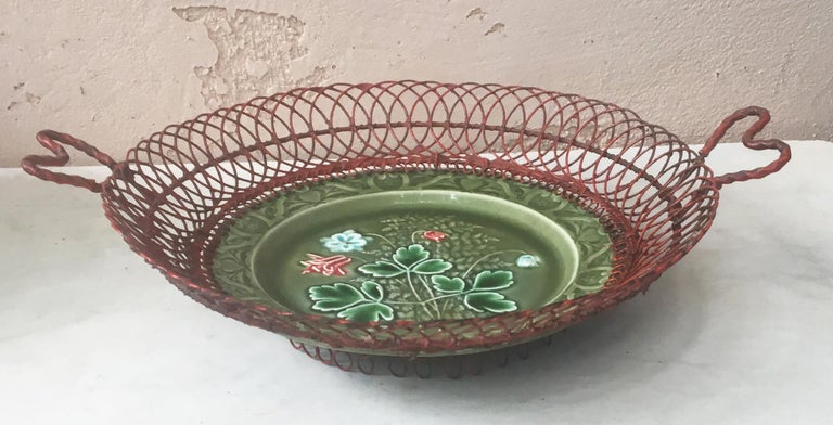 Lovely German Majolica basket with red wire decorated with red flowers, circa 1900.