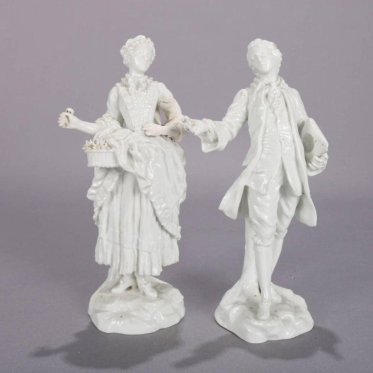 German Meissen Blanc de Chine style porcelain figures of courting couple in Colonial garb, crossed sword mark on base, circa 1880.  Measure: 9.5