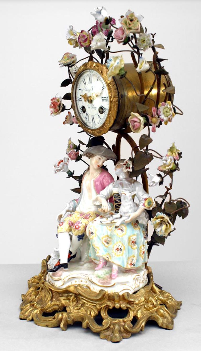 German Meissen (19th Century) porcelain group of men and women with floral and bronze branches around mantel clock (not working)