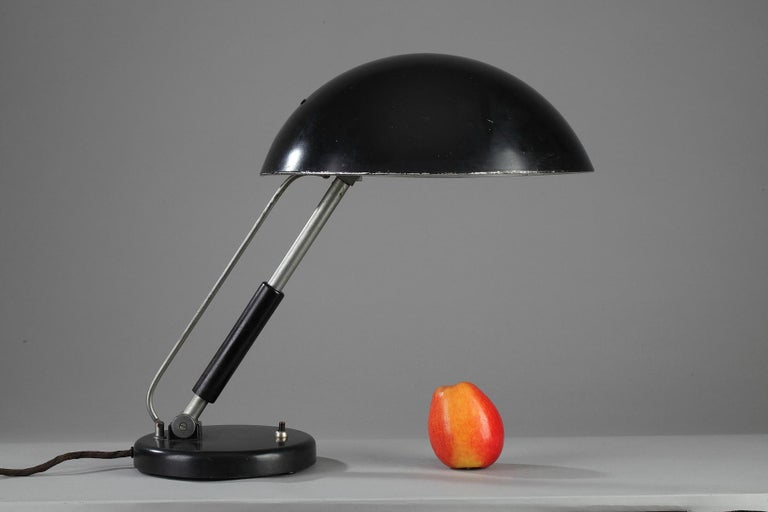 Karl Trabert modernist table lamp with chrome-plated tubular stem and enameled metal shade. Manufactured by G. Schanzenbach, Germany during the 1930s and 1940s. All that is known about Karl Trabert is that he was in steady contact with the most