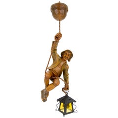 German Pendant Light of a Hand Carved Wood Figure Mountain Climber with Lantern