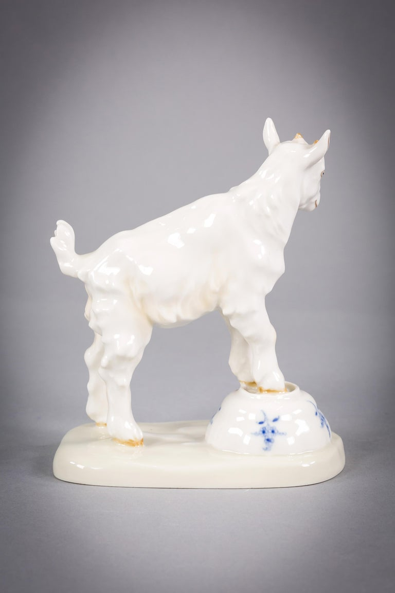 Goat standing on an up turned Meissen bowl. The liquid from the up turned bowl visible on the base of the figure.