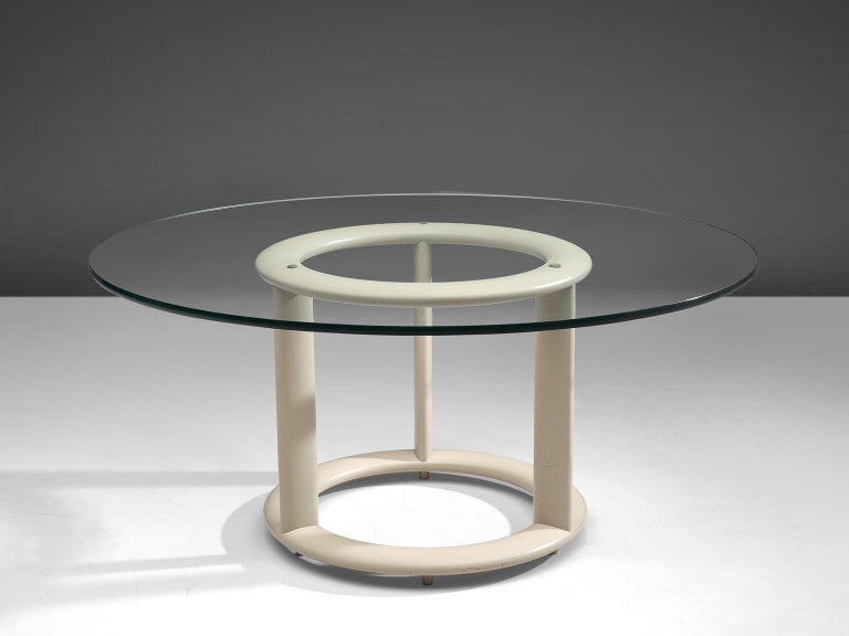 Rosenthal Studio Linie, dining table, glass and painted wood, Germany, 1970s  This postmodern centre table with white lacquered circular foot features a round glass top. The model is very minimalistic, featuring a base with only the necessary