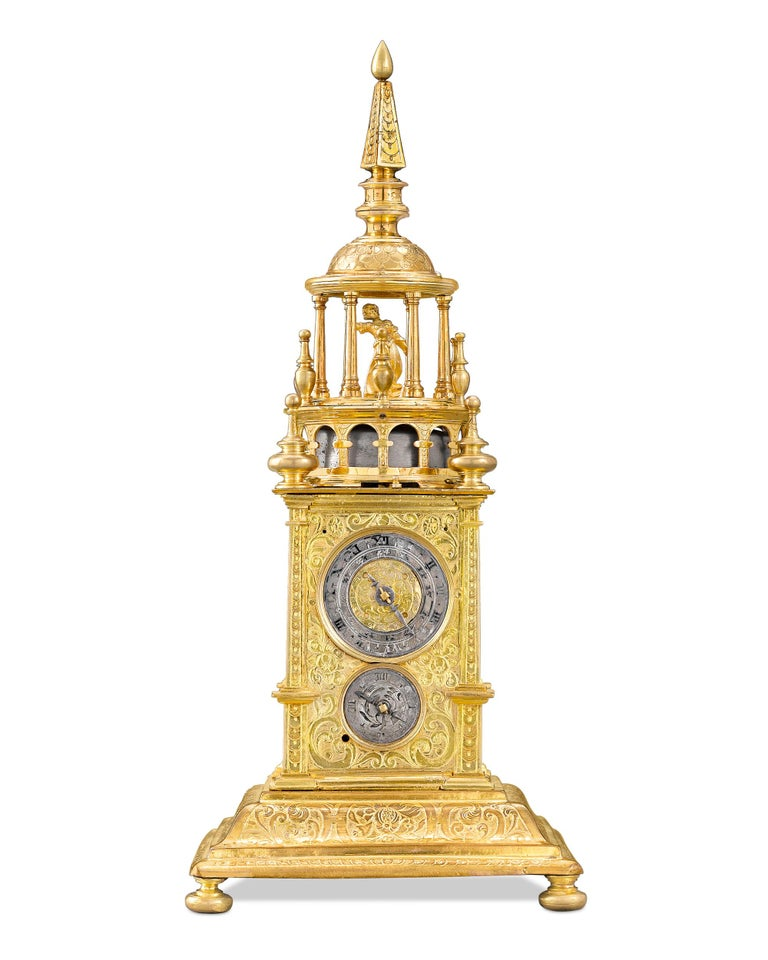 This immensely rare Renaissance turret-form clock, or the table clock, was considered both a scientific marvel and an item of luxury during the period. This incredible piece is encased in fire gilt brass crafted to resemble the giant striking clocks