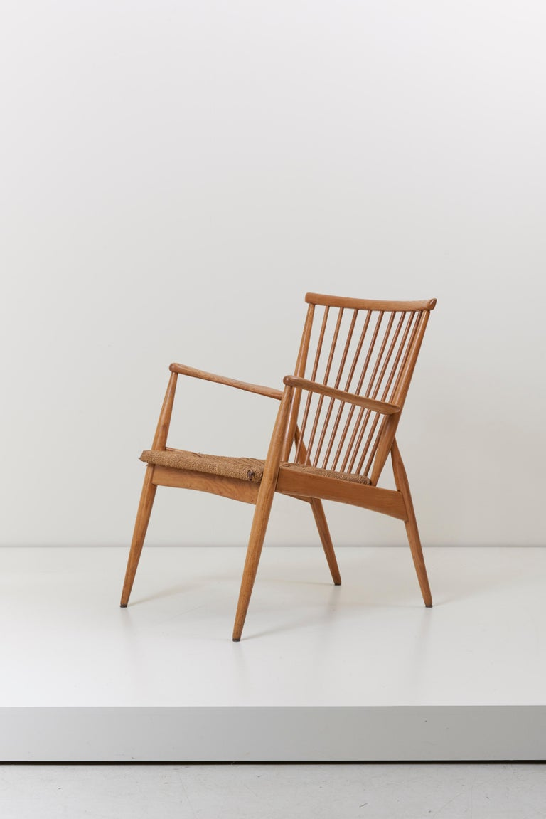 German studio lounge chair with paper cord seat and solid ash frame.