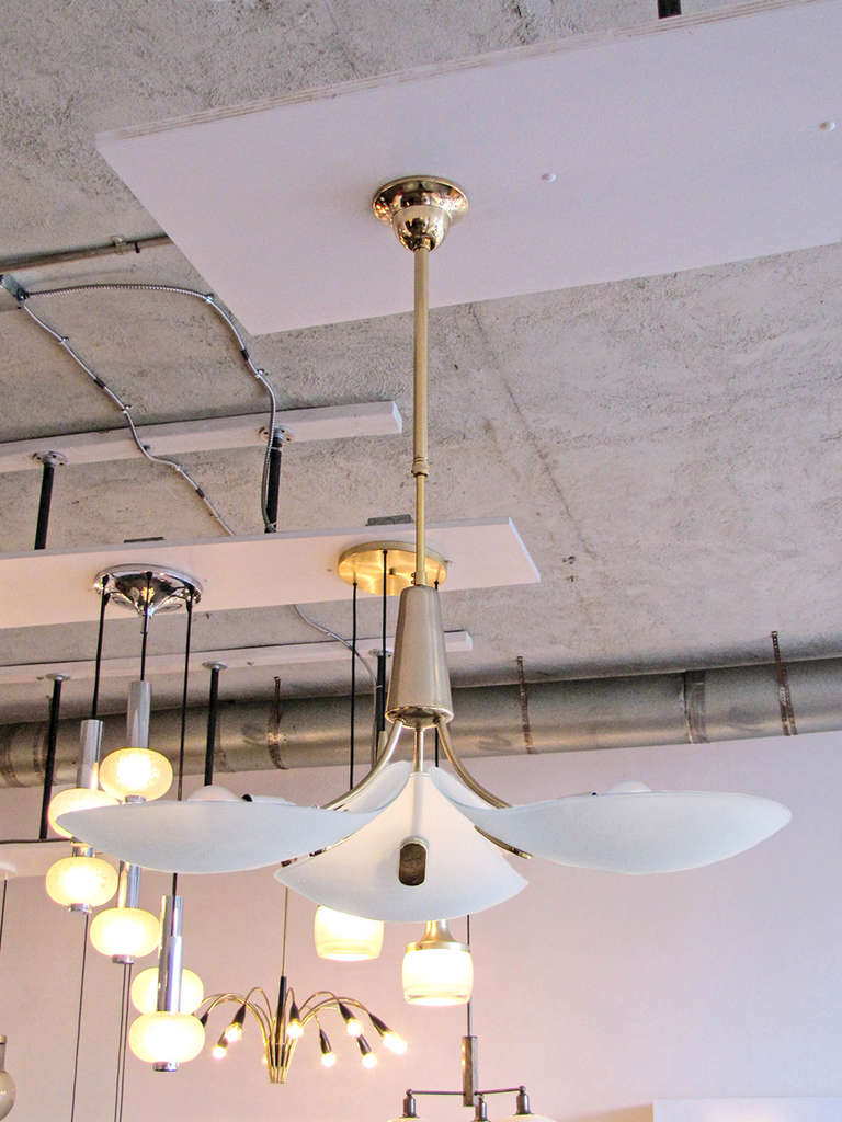 Striking German 3-arm brass & glass chandelier, the frosted glass leaves feature an etched concentric ring pattern, a telescope suspension allows for an overall height adjustment, wired for US standards, three E27 sockets, max. wattage 60w per