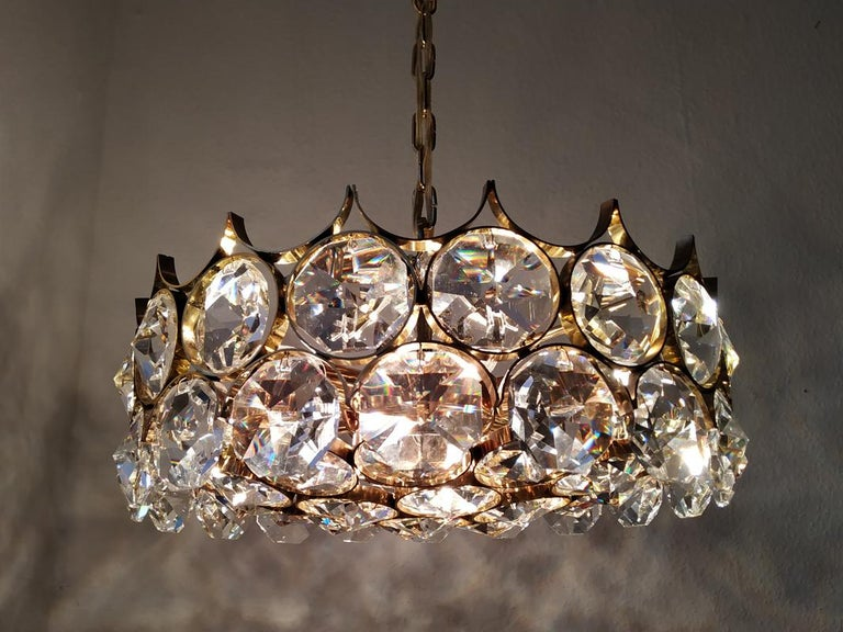 Wonderful crystal glass and gold-plated brass pendant chandelier by Palwa (Palme & Walter). Germany, 1960s. Measures: Diameter 17.5 in Height (body) 9 in. Lamp sockets: 7.