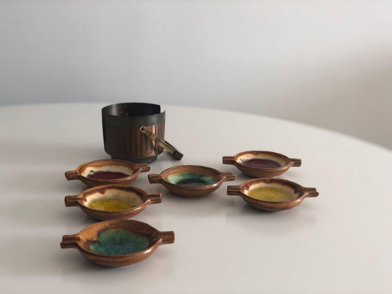 20th century vintage individuals German ashtrays in a portable copper holder that you can carry. Each ashtray is set in one of the following tones: red, yellow and green lava glazing.