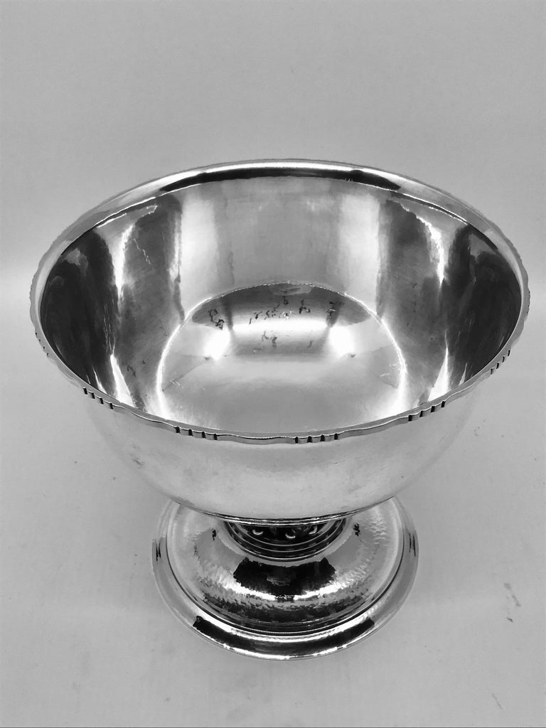 Sterling silver Georg Jensen bowl, design #19A by Georg Jensen from 1912. This design was purchased in 1914 by the Louvre museum in Paris for their permanent collection and is commonly referred to as the Louvre bowl. Several sizes were later