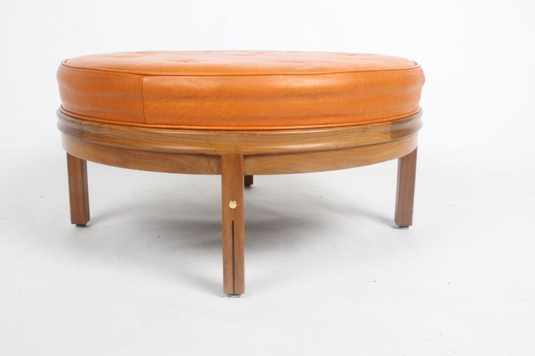 Gerry Zanck for Gregori, Round Orange Leather Pouf or Ottoman on Walnut base  For Sale 1