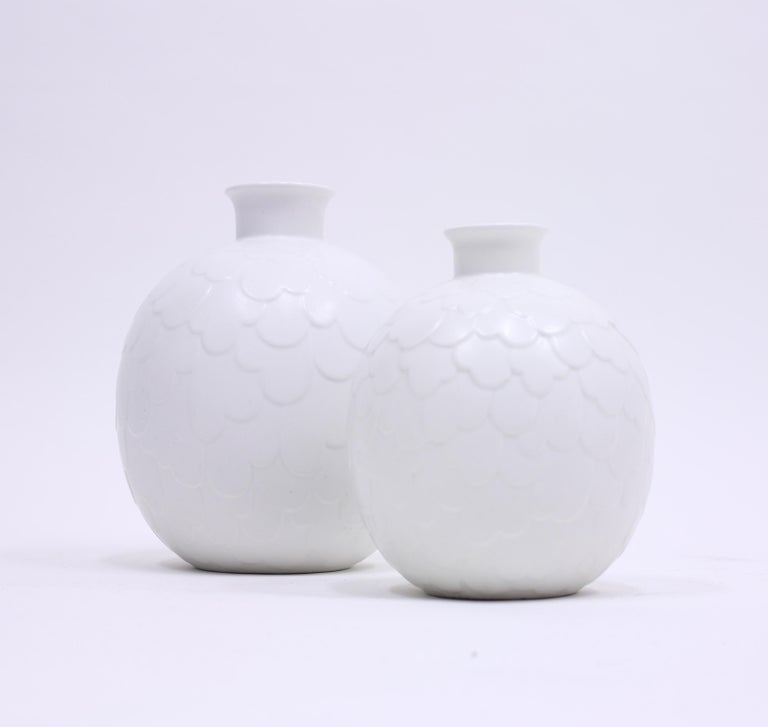 Rare set of 2 vases from the Capri series designed by Gertrud Lönegren for Swedish manufacturer Rörstrand in the 1950s. The vases are in two different sizes. The smallest are 17 cm high and have a diameter of 14 cm. The larger one is 22 cm high and