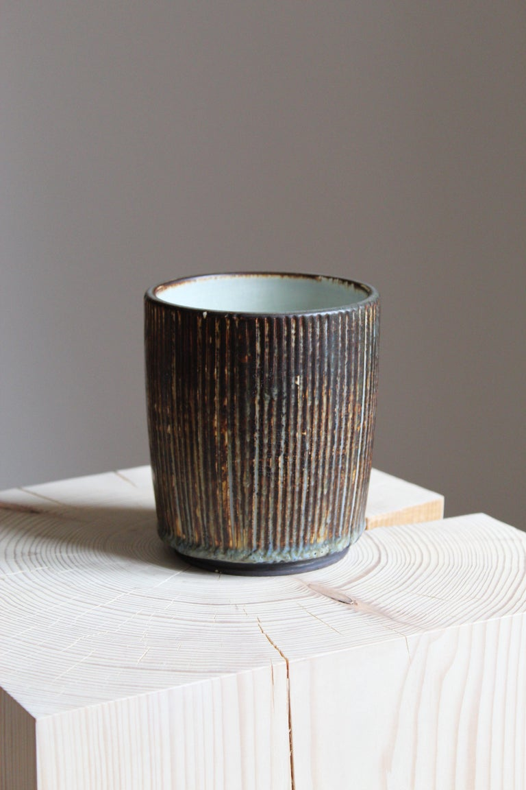 A small vase, designed by Getrud Lönegren. Produced by Rörstrand. Stamped. Features a highly artistic glaze.  Other designers of the period include WIlhelm Kåge, Stig Lindberg, Axel Salto, Arne Bang, and Gunnar Nylund.