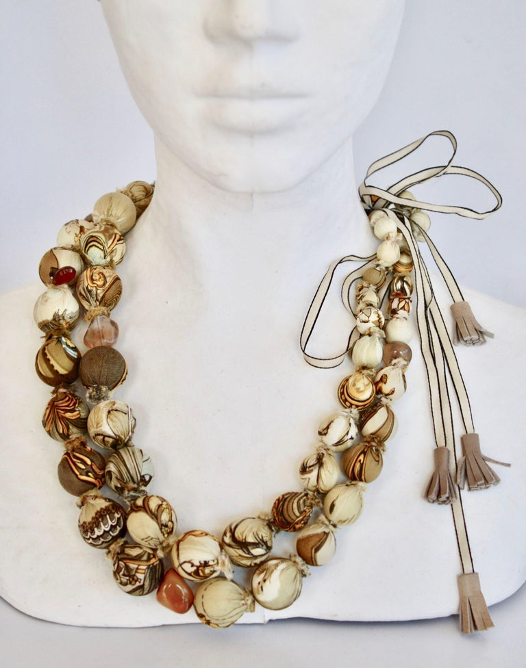 One of a kind double row bead necklace hand wrapped with authentic vintage silk Hermes scarves and finished with authentic Hermes leather tassels. by Gordana Gasparovic.  Adjustable length.