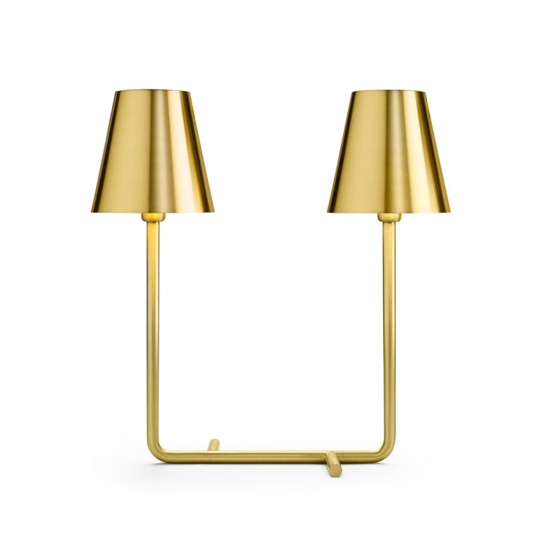 Bio table lamp in satin brass by A. Cibic.  Materials: Satin brass Net weight: 2.35 Dimensions: W 40 x D 17 x 42 H cm.