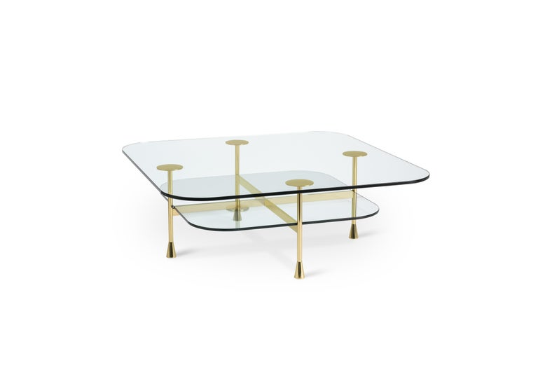 Side table in crystal and brass The Vitruvian man and the idea of the human body perfection: this is how the designer sees this central coffee table shaped perfectly with the squared and round shape. The glass, in the double overlapping layer,
