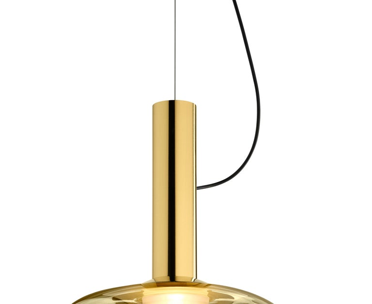 Suspension lamp. An intersection game of two forms to define a soft and geometric tone, a cloud of light arising from the glass diffuser seated on a solid brass cone.