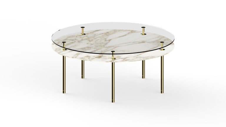 Round table in crystal and brass. The designer imagines a turning point in the use of such a precious finishes such as polished brass: from the idea of almost a unique object in its perfect craftsmanship, to the system to be built starting from the