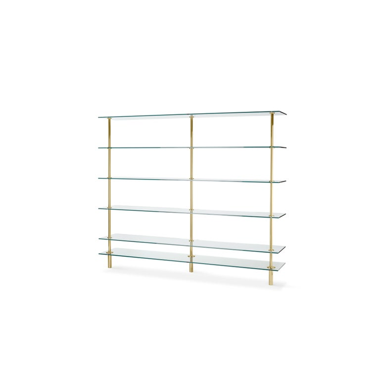 Bookshelves in crystal and brass. The designer imagines a turning point in the use of such a precious finishes such as polished brass: from the idea of almost a unique object in its perfect craftsmanship, to the system to be built starting from the