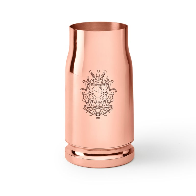 Based on a tale of two wild girls traveling across the US, the Nowhere bullet vase feature iconic Studio Job engravings and a typical oversized form giving a unique look to this piece.  Materials: Copper-plated brass.
