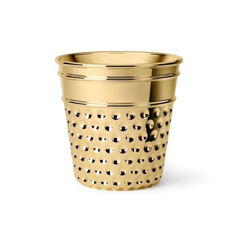 Ice bucket in casted brass. For this supreme ice bucket Studio Job got inspirations by family tailoring traditions and care of the smallest details. The here ice bucket is then represented by a gigantic thimble with etchings.