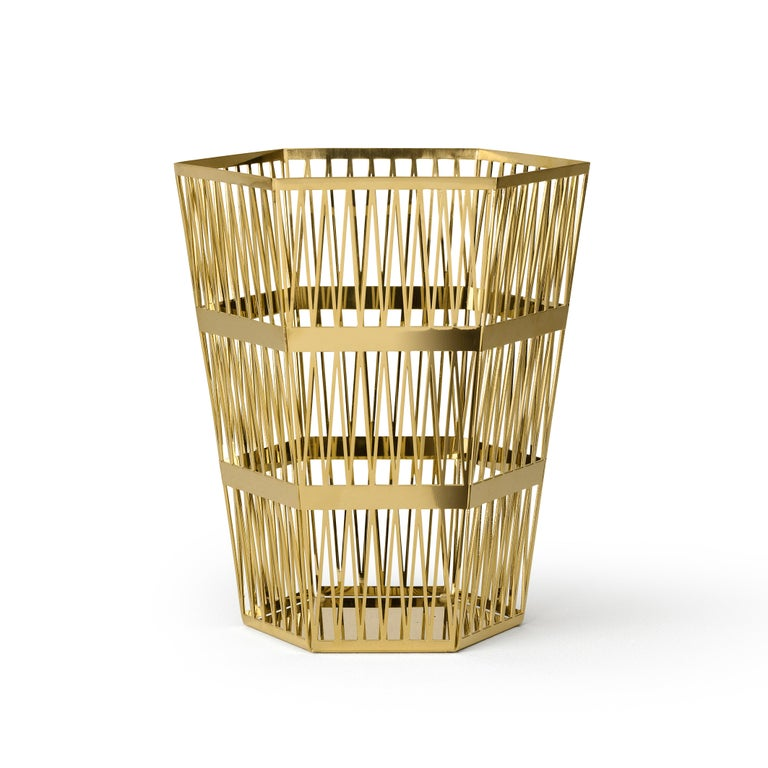 Large paper basket in openwork steel When you look at the top view of the Tip-Top series, all the triangles have the same size. In 3D these triangles have been stretched, which creates a very surprising hexagonal structure, applied to different