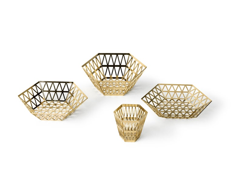 Tray in openwork steel When you look at the top view of the Tip-Top series, all the triangles have the same size. In 3D these triangles have been stretched, which creates a very surprising hexagonal structure, applied to different