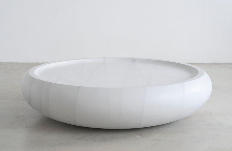 One of three pieces from the GHOST collection, the coffee table is cast entirely in cement. With an initial form carved in foam by a robotic arm, cement is poured to create the large-scale, heavy, and pristine piece to emulate the gravity of nature
