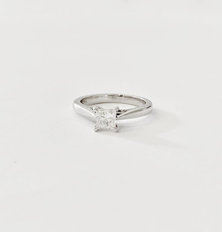 This elegant GIA 0.50ct Princess Cut diamond is claw set a Platinum band with a diamond accent on the curve of the band under the stone.  The Diamond is Certified as G colour and VS2 Clarity and measures 4.36 - 4.20 x 3.21.  The ring weight for the