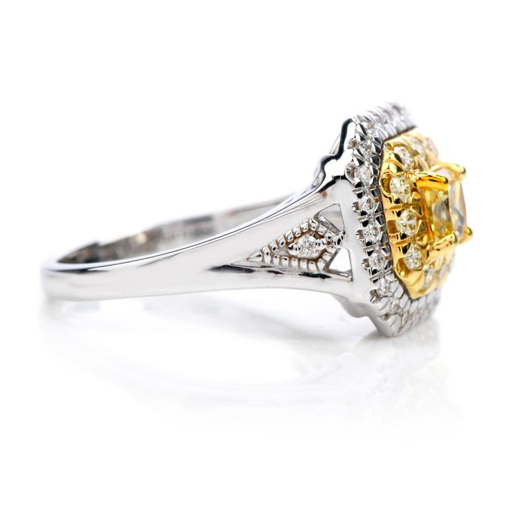 Vibrant double halo design, this GIA-certified natural yellow Diamond engagement ring is exquisite!  Crafted in solid 18K white gold with yellow gold accents, the center is adorned by a GIA-certified princess-cut natural fancy yellow diamond, with a