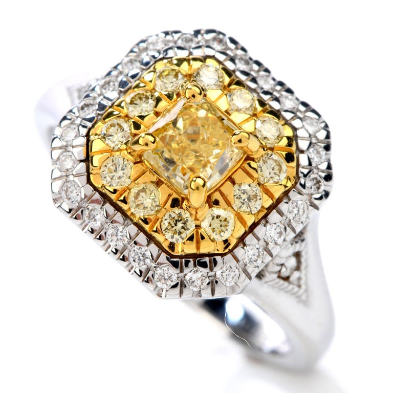 GIA 0.65 Carat Fancy Yellow Diamond 18K Gold Halo Engagement Ring In Excellent Condition For Sale In Miami, FL