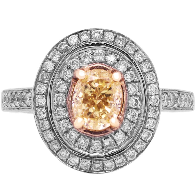 GIA 1.06 Carat VS1 Fancy Intense Yellow Diamond Ring with Diamonds White Gold For Sale