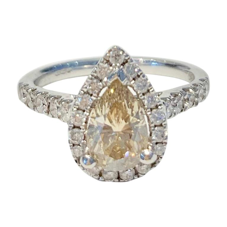 GIA 1.07 Carat Fancy Color Pear Cut Diamond Ring in 18 Carat Gold Halo Setting For Sale