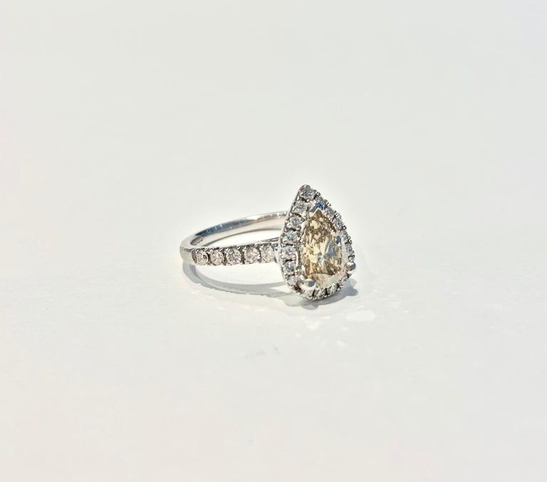 Modern GIA 1.07 Carat Fancy Color Pear Cut Diamond Ring in 18 Carat Gold Halo Setting For Sale