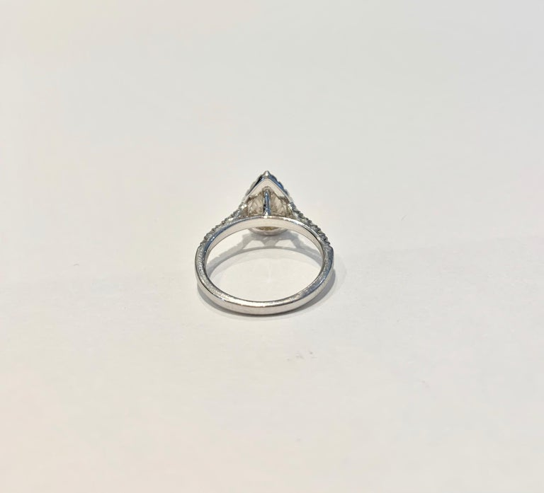GIA 1.07 Carat Fancy Color Pear Cut Diamond Ring in 18 Carat Gold Halo Setting For Sale 1