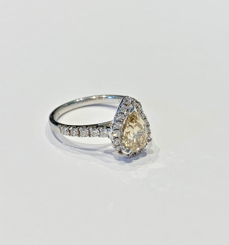 GIA 1.07 Carat Fancy Color Pear Cut Diamond Ring in 18 Carat Gold Halo Setting For Sale 2