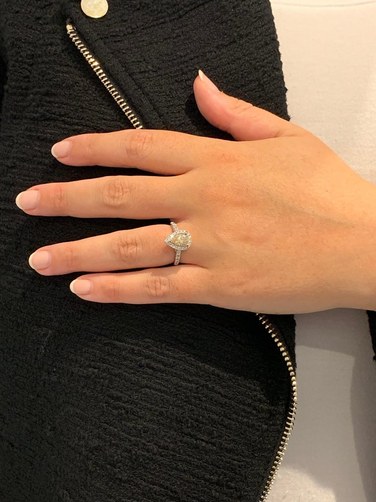 GIA 1.07 Carat Fancy Color Pear Cut Diamond Ring in 18 Carat Gold Halo Setting For Sale 4