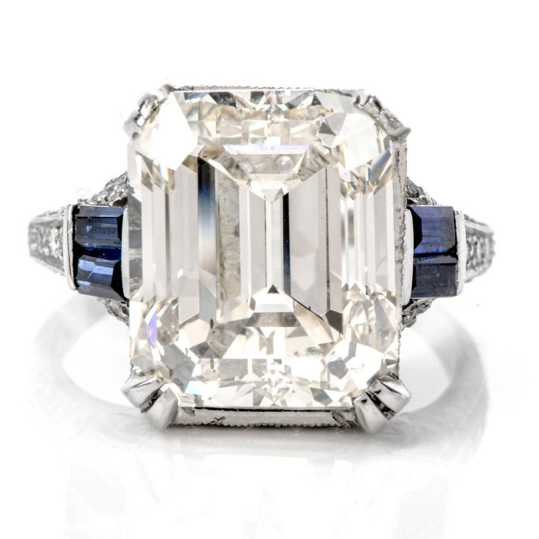 Show your art-deco side, with this candle-light romantic, emerald cut diamond engagement ring!  Considered to be one of the most elegant cuts of diamond, this GIA Diamond Sapphire Platinum Emerald Cut Filigree  Engagement Ring, hosts a 10.21 carat