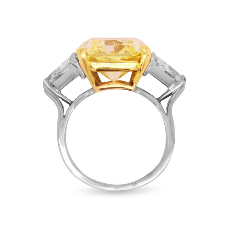 Contemporary GIA 11.22 Carat VVS1 Fancy Intense Yellow Diamond Ring with Trillion Diamonds For Sale