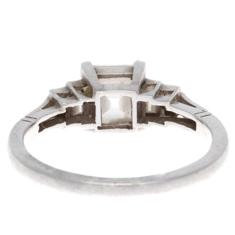 Art Deco GIA 1.17 Carat E VVS2 Rectangular Step Cut Diamond Platinum Engagement Ring For Sale
