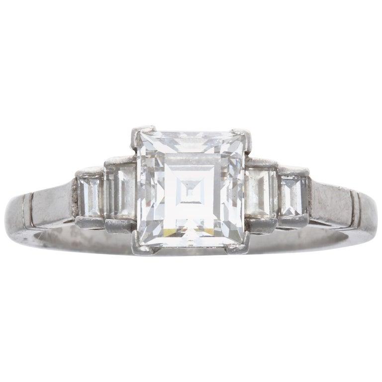 GIA 1.17 Carat E VVS2 Rectangular Step Cut Diamond Platinum Engagement Ring For Sale