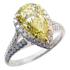 GIA 1.20 Carat Fancy Light Yellow Pear Shaped 18 Karat Gold Ring with Halo